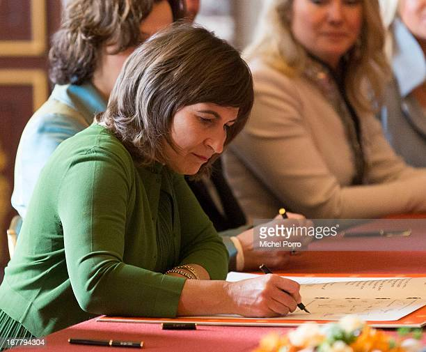Minister for Foreign Trade and Development Cooperation Lilianne Ploumen signs the Act of Abdication of Queen Beatrix of the Netherlands in the...
