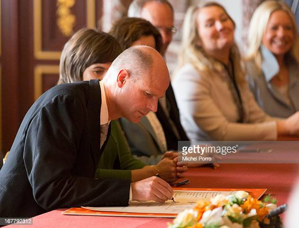 Minister for Housing and Civil Service Stef Blok signs the Act of Abdication of Queen Beatrix of the Netherlands in the Moseszaal at the Royal Palace...