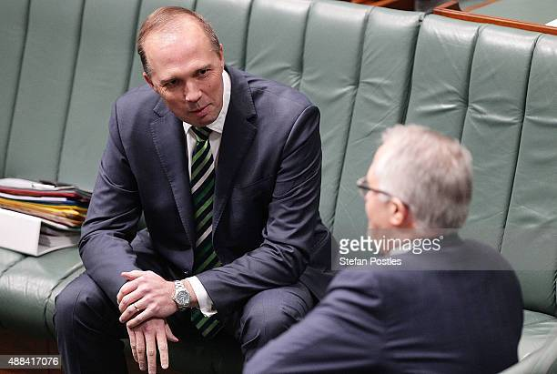 Minister for Immigration and Border Protection Peter Dutton speaks to Prime Minister Malcolm Turnbull during House of Representatives question time...