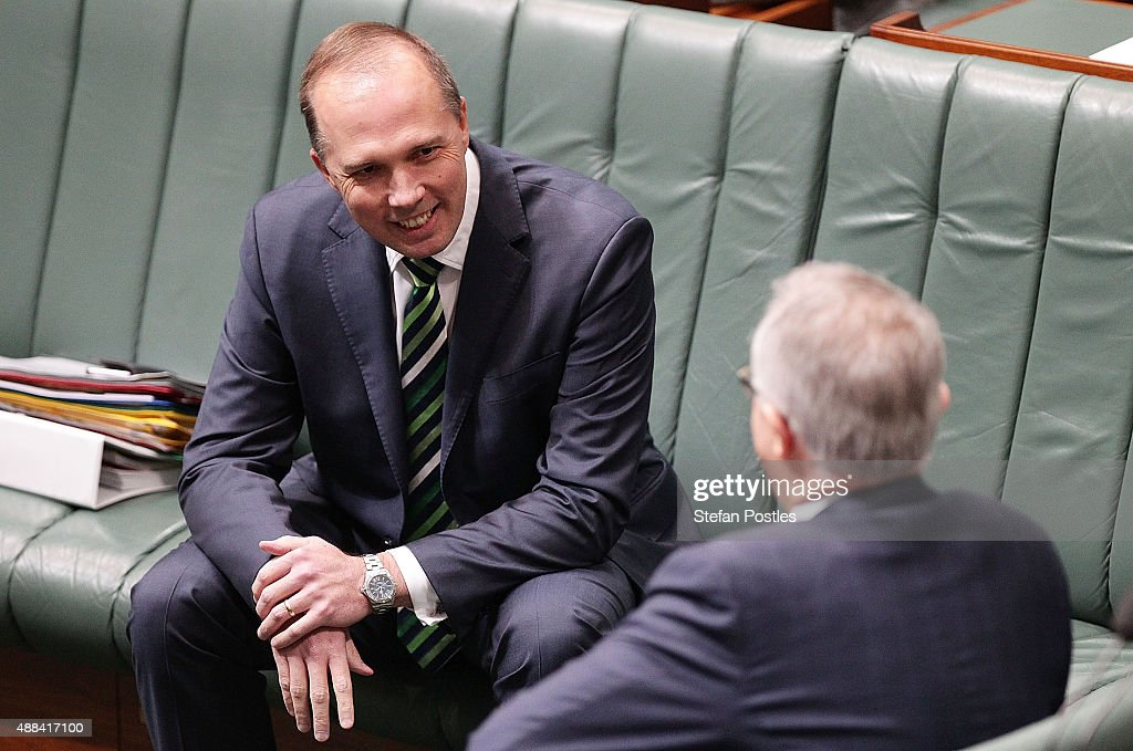 Minister for Immigration and Border Protection Peter Dutton speaks to Prime Minister Malcolm Turnbull during House of Representatives question time at Parliament House on September 16, 2015 in Canberra, Australia. Malcolm Turnbull was sworn in as Prime Minister of Australia on Tuesday, replacing Tony Abbott following a leadership ballot on Monday night.
