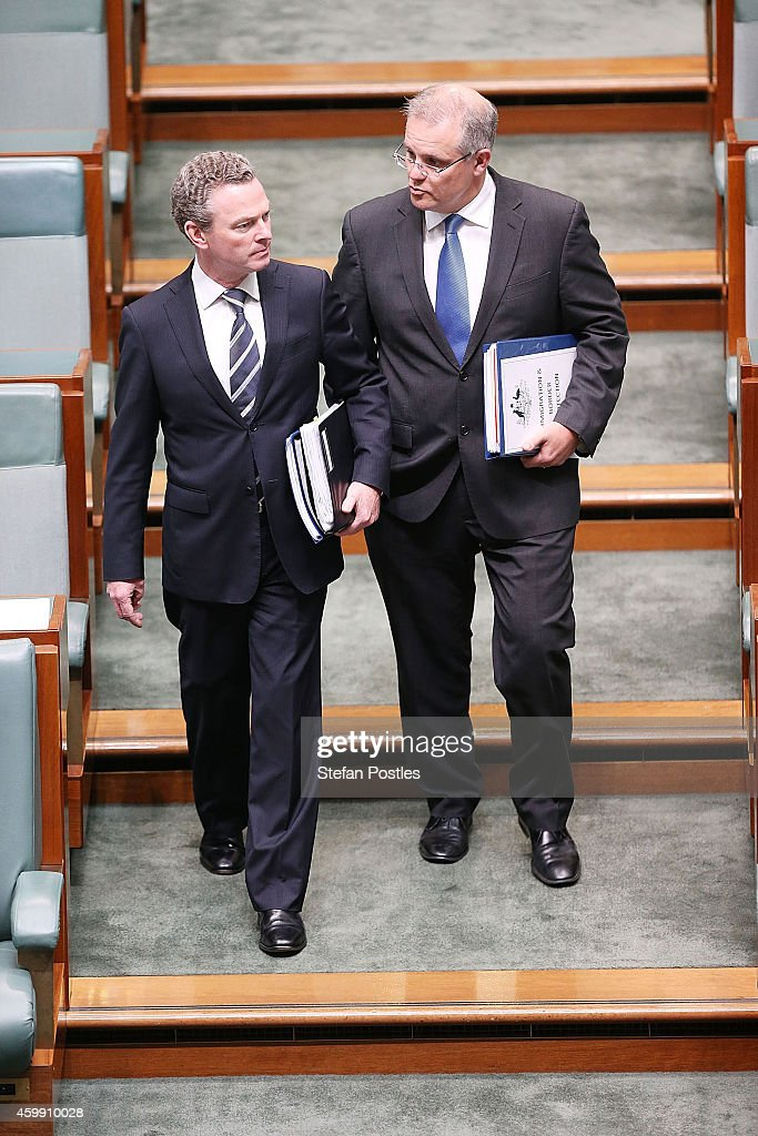 Minister for Immigration and Border Protection Scott Morrison and Minister for Education Christopher Pyne arrive for House of Representatives question time at Parliament House on December 4, 2014 in Canberra, Australia. Today is the official last day of sitting at Parliament for 2014. Parliament will return on February 9, 2015.