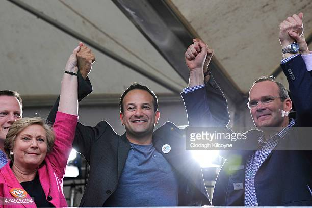 Minister for Justice Frances Fitzgerald Minister Leo Varadkar Simon Coveney TD celebrate a landslide victory of a Yes vote after a referendum on same...