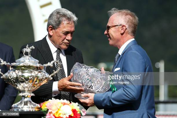Minister for Racing and Deputy Prime Minister Winston Peters presents coowner Tony Pike with the owners trophy after winning the Wellington Cup with...