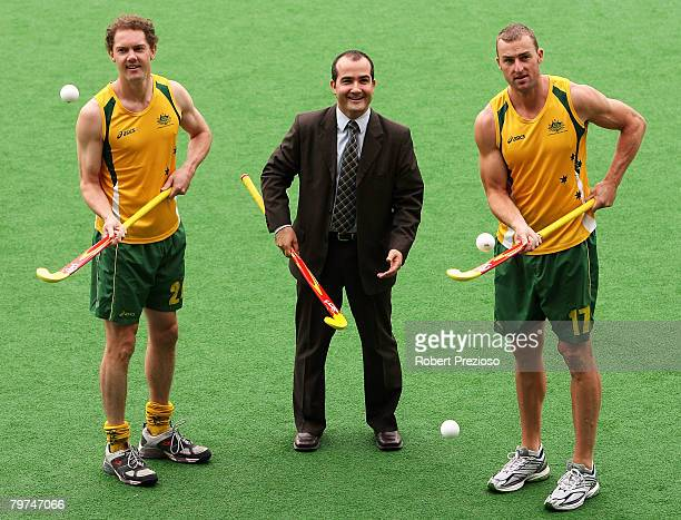 Minister for sport and recreation James Merlino and players Travis Brooks and Andrew Smith pose at the state Netball and Hockey Centre February 14,...