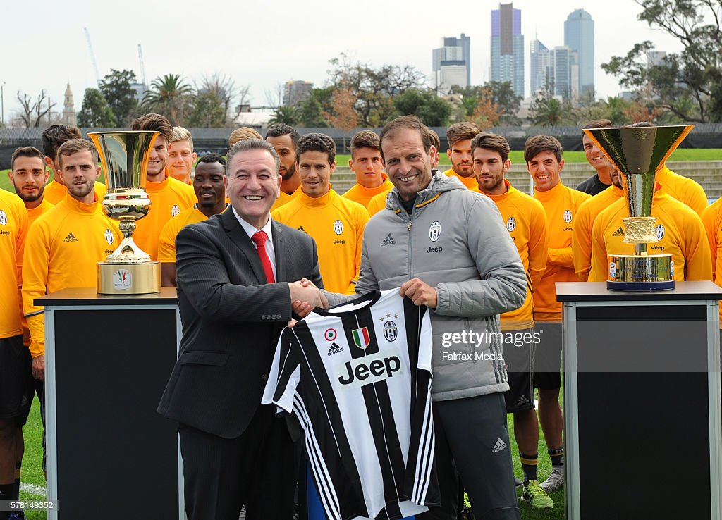 Minister for Sport John Eren (L) is presented with a jersey by Juventus manager Massimiliano Allegri ahead of the club's training session at Lakeside Stadium on July 19, 2016 in Melbourne, Australia.