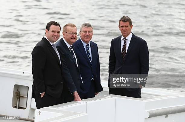 Minister for Sport Stuart Ayres IOC Vice President John Coates IOC President Thomas Bach speaks and NSW Premier Mike Baird look on from a boat on...
