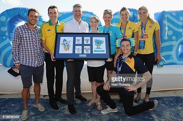 Minister for Transport and the Commonwealth Games Stirling Hinchliffe and design winner Merrilyn Krohn pose with Courtney Atkinson Michael Shelley...
