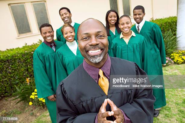 minister in front of gospel choir - pastor stock pictures, royalty-free photos & images
