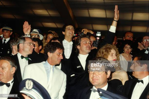 Minister Jack Lang, actors Alain Delon and Domiziana Giordano attend the 43th Cannes film Festival on May 1990 in Cannes, France.