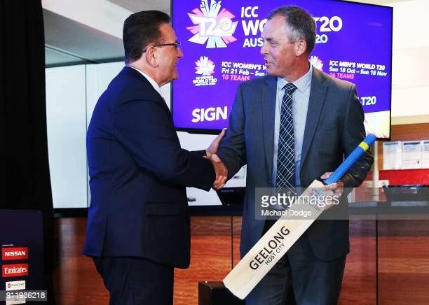 Minister John Eren accepts a cricket bat from Tony Dodemaide of Cricket Victoria during the ICC World T20 media opportunity at on January 30 2018 in...