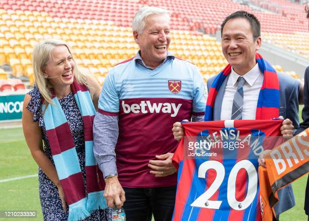 Minister Kate Jones Alan Graham GM of Suncorp Stadium and Victor Hsiao of EVA air pose during an International Champions Cup media opportunity ahead...