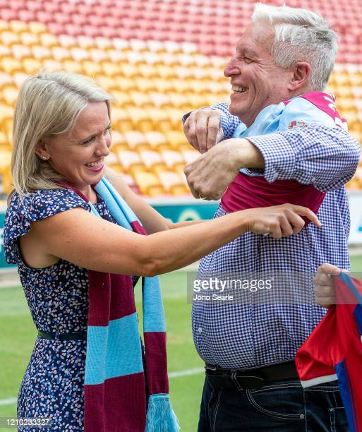 Minister Kate Jones helps Alan Graham GM of Suncorp Stadium put on a West Ham jersey during an International Champions Cup media opportunity ahead of...