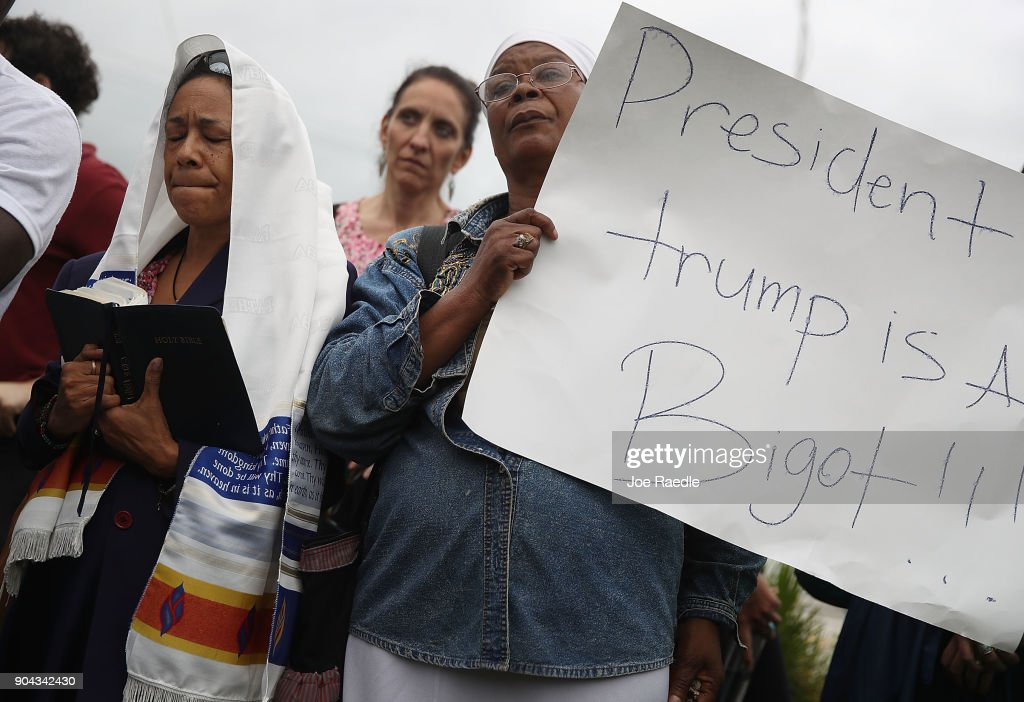 Minister Lorna Shuford and Pastor Marie Belizaire (L-R) join with others to mark the 8th anniversary of the massive earthquake in Haiti and to condemn President Donald Trump's reported statement about immigrants from Haiti, Africa and El Salvador on January 12, 2018 in Miami, Florida. President Trump is reported to have called those places 'shithole countries' whose inhabitants are not desirable for U.S. immigration.