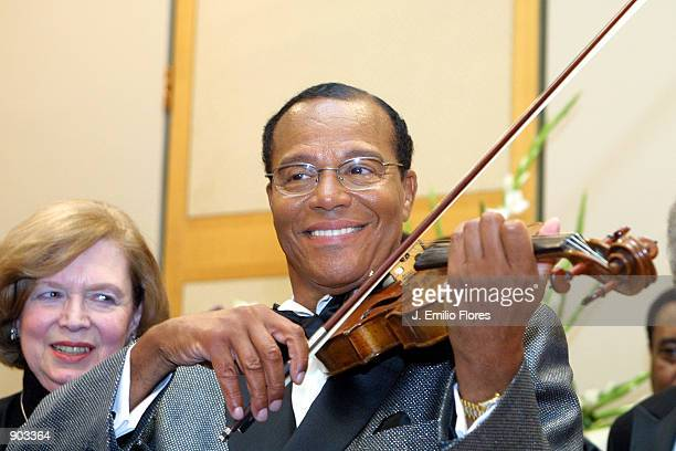 Minister Louis Farakhan plays the violin during a press conference and a classical music concert that served as a kickoff for the Nation of Islam...
