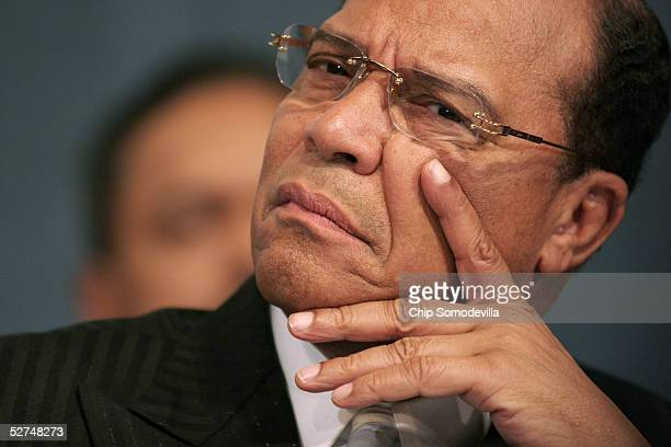 Minister Louis Farrakhan leader of the Nation of Islam listens to the comments of other national civic political and religious leaders during a news...
