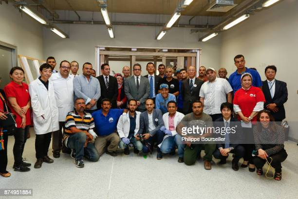 Minister of Antiquities Khaled El Enany and GEM Director Dr Tarek Sayed Rawfik along with members of his conservation and restoration team in front...