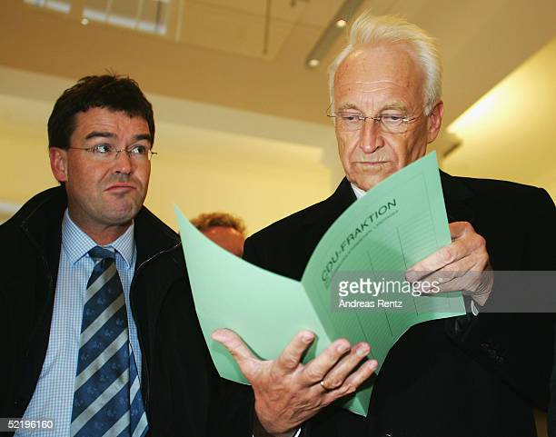 Minister of Bavaria Edmund Stoiber takes a look at his brief before giving a press conference while campaigning for CDU in regional elections for...