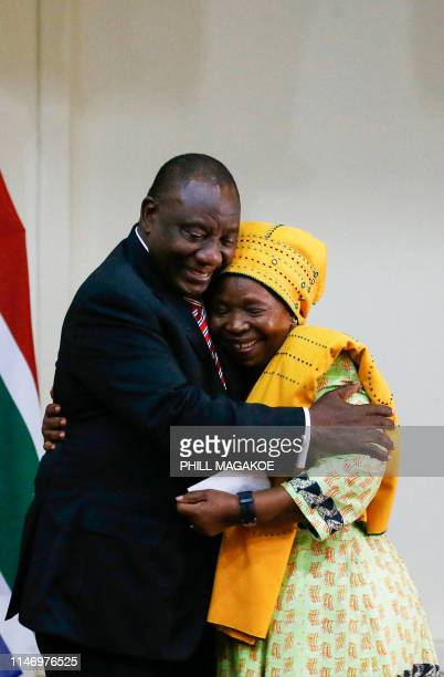 Minister of Cooperative Governance and Traditional Affairs Dr Nkosazana Dlamini-Zuma is hugged by South African President Cyril Ramaphosa after being...