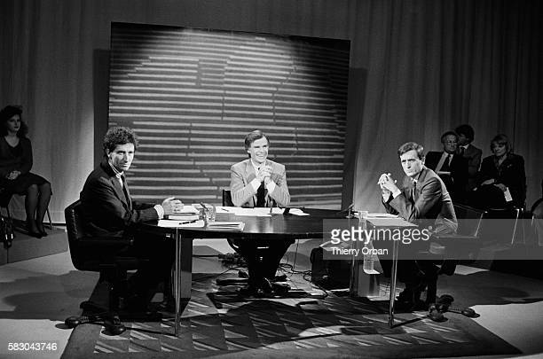 Minister of Culture Jack Lang and general secretary of the Republican Party Francois Leotard attend a debate on TF1 prior to the 1985 French regional...