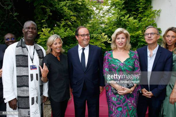 Minister of Culture of Cote d'Ivoire Maurice Kouakou Bandaman journalist Claire Chazal Former French President Francois Hollande First lady of Cote...