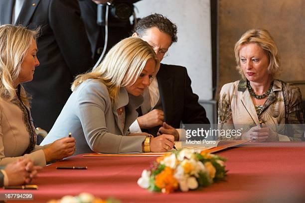 Minister of Defence Jeanine HennisPlasschaert signs the Act of Abdication of Queen Beatrix of the Netherlands in the Moseszaal at the Royal Palace on...
