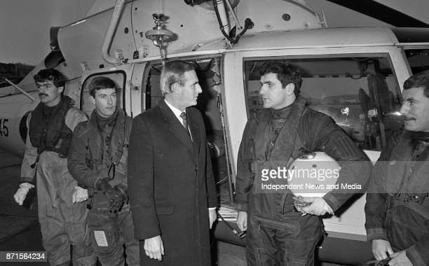 Minister of Defence Michael J Noonan looking over the cockpit of a Irish Air Corps Dauphin Helicopter at Baldonnel Aerodrome with pilot Comdt Aiden...