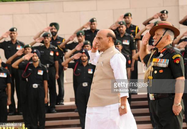 Minister of Defence Rajnath Singh and Army chief General Bipin Rawat pay their tribute at National War Memorial on July 14 2019 in New Delhi India...