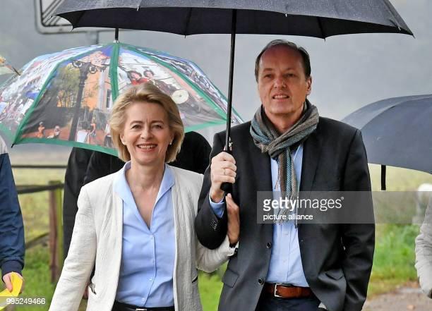 Minister of defence Ursula von der Leyen and her husband Heiko von der Leyen walk to a polling station in Beinhorn Germany 24 September 2017 They...
