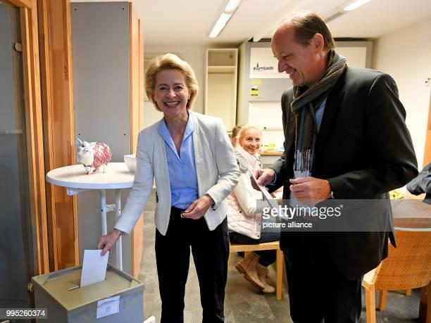 Minister of Defence Ursula von der Leyen and her husband Heiko von der Leyen cast their votes at a polling station in Beinhorn Germany 24 September...
