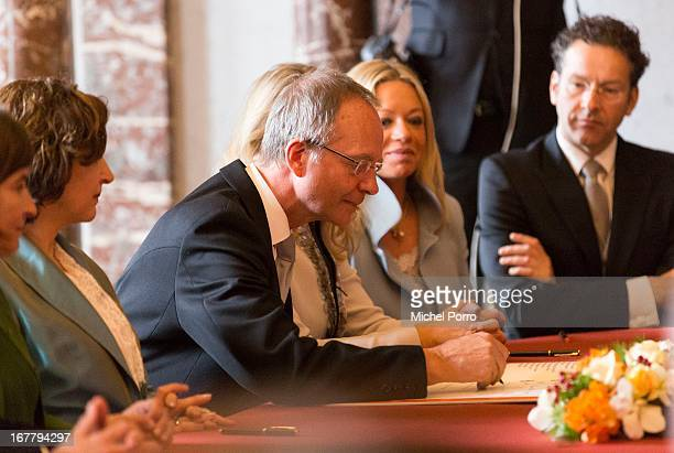 Minister of Economic Affairs Henk Kamp signs the Act of Abdication of Queen Beatrix of the Netherlands in the Moseszaal at the Royal Palace on April...