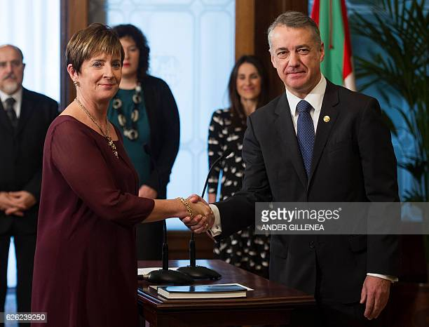 Minister of Economic Development and Infrastructure Arantxa Tapia shakes hands with Basque regional president 'Lehendakari' Inigo Urkullu after...