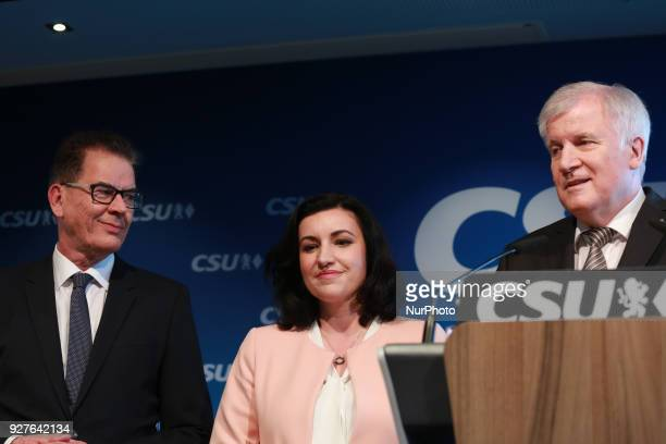 Minister of economic relations and development Gerd Müller and CSU's vice chairman Dorothee Baer stand next to Designated minister of interiour and...