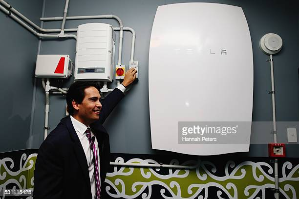 Minister of Energy and Resources Simon Bridges switches on the Tesla Powerwall battery at Rongomai School on May 13 2016 in Auckland New Zealand The...