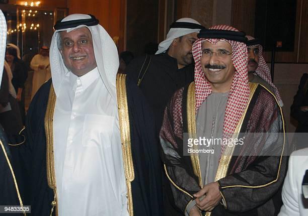 Minister of Energy Mohamed bin Dhaen alHamli right and Qatari Minister of Energy and Industry Abdullah Bin Hamad alAttiyah left speak to the press...