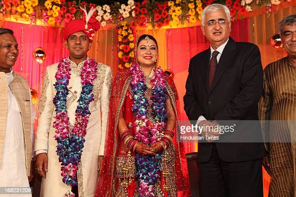 Minister of External Affairs Salman Khurshid with couple Ashok Basoya and Ragini Nayak at their Wedding ceremony on May 5 2013 in New Delhi India