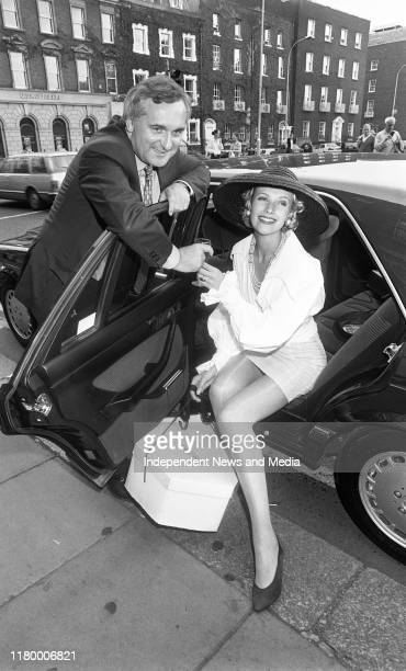 """Minister of Finance Bertie Ahern with Model Jenny Bent outside the Shelbourne Hotel, Where he unveiled a promotion """"Live Free For A Year"""" in which..."""