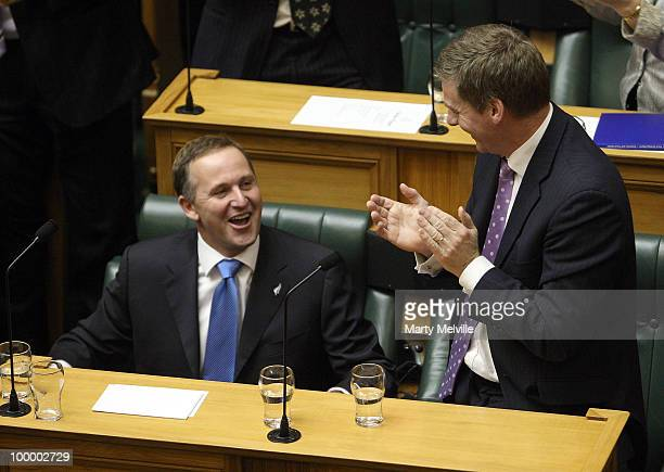 Minister of Finance Bill English congratulates Prime Minister of New Zealand John Key on his speech after the reading of the Budget in Parliament...