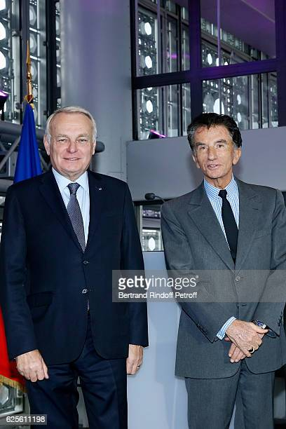 Minister of Foreign Affairs and International Development, Jean-Marc Ayrault and President of the 'Institut du Monde Arabe' Jack Lang attend the...