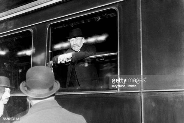 Minister of Foreign Affairs Aristide Briand leaving by train at the Gare du Nord station to attend the London Conference on February 4 1930 in Paris...