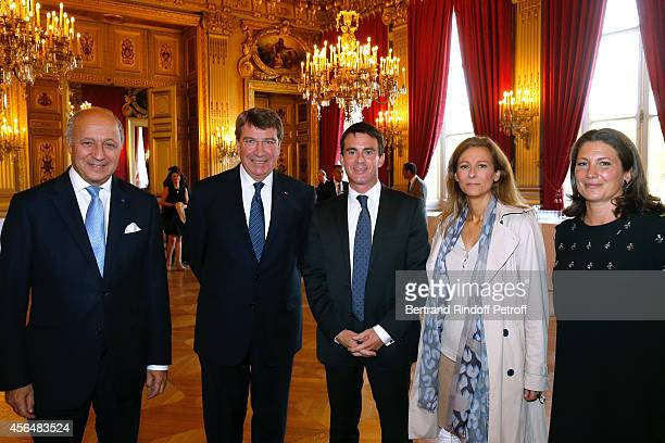 Minister of Foreign Affairs Laurent Fabius Xavier Darcos French Prime Minister Manuel Valls his wife Anne gravoin and Laure Darcos attend Xavier...