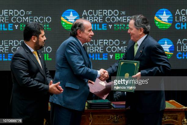Minister of Foreign Affairs of Chile Roberto Ampuero exchanges the signing document for the Free Trade Agreement with Minister of Foreign Affairs of...