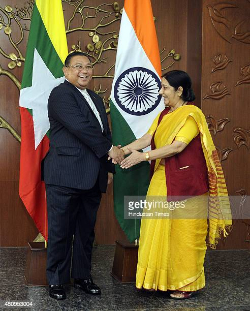 Minister of Foreign Affairs of Myanmar U Wunna Maung Lwin shakes hand with External Affairs Minister Sushma Swaraj during the IndiaMyanmar Joint...