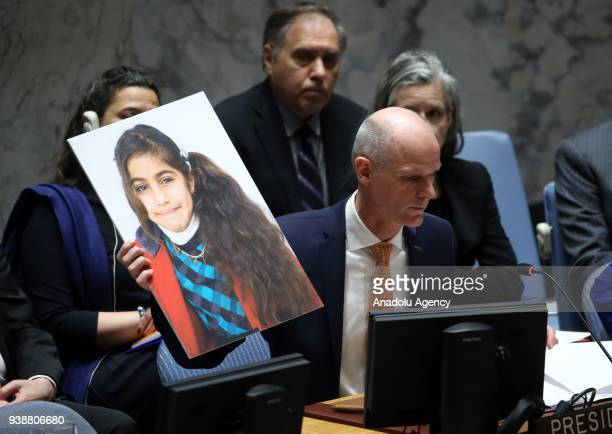 Minister of Foreign Affairs of Netherlands Stef Blok holds a picture of a 7 year old Syrian girl during a UN Security Council meeting on Syria at...