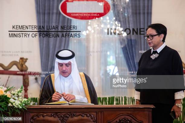 Minister of Foreign Affairs of Saudi Arabia Adel alJubeir signs the guestbook ahead of a press conference with Indonesian Foreign Minister Retno...