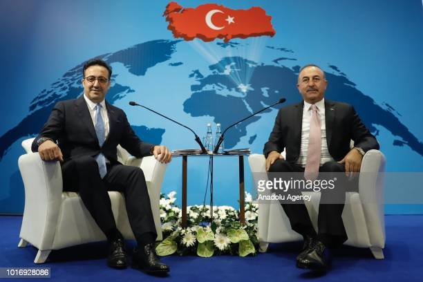 Minister of Foreign Affairs of Turkey Mevlut Cavusoglu and Chairman of the Board and Executive Committee of Turkish Airlines Ilker Ayci pose for a...