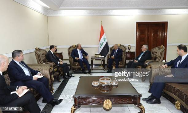 Minister of Foreign Affairs of Turkey Mevlut Cavusoglu chats with Adil AbdulMahdi who is assigned by Iraq's President Barham Salih to form the new...