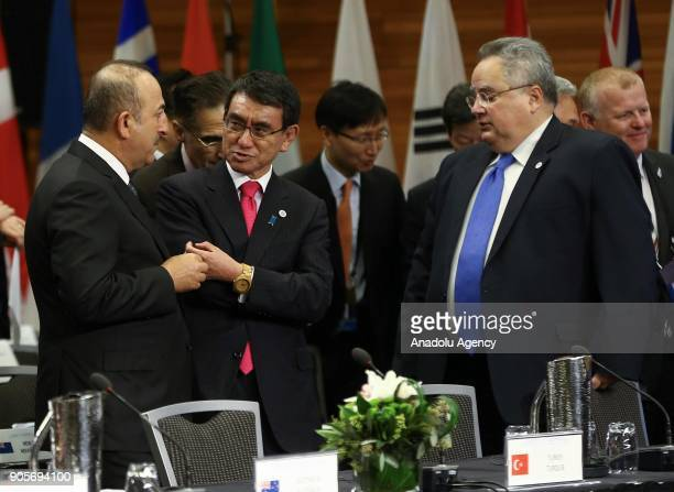 Minister of Foreign Affairs of Turkey Mevlut Cavusoglu chats with Japan's Foreign Minister Taro Kono and Minister for Foreign Affairs of Greece Nikos...