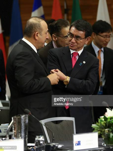 Minister of Foreign Affairs of Turkey Mevlut Cavusoglu chats with Japan's Foreign Minister Taro Kono during Vancouver Foreign Ministers Meeting on...