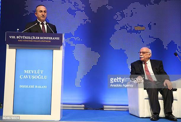 Minister of Foreign Affairs of Turkey Mevlut Cavusoglu delivers a speech as Minister of National Education of Turkey Nabi Avci sits on the stage...
