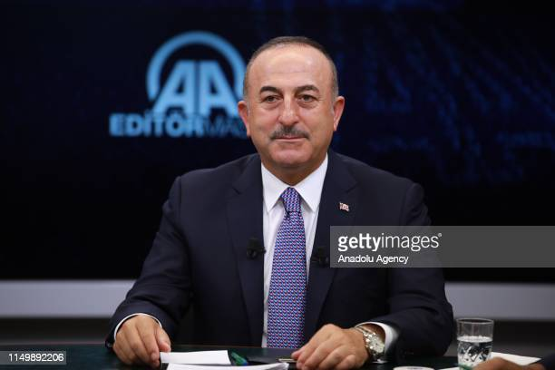 Minister of Foreign Affairs of Turkey Mevlut Cavusoglu gestures as he is special guest of Anadolu Agency's Editors Desk in Ankara Turkey on June 14...